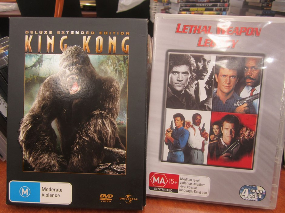 Box of DVD action movies including Deluxe extended edition King Kong,