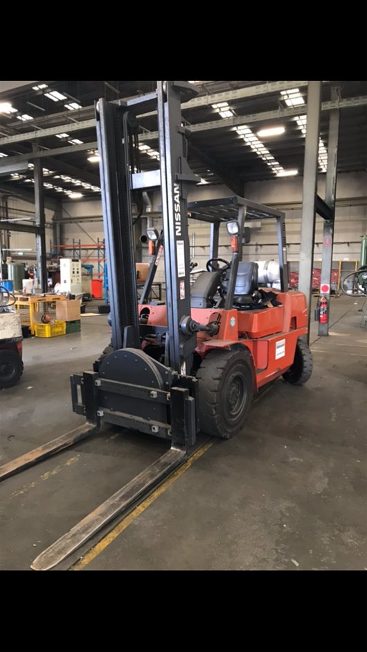 2006 Nissan Forklift with the Rotary Attachment