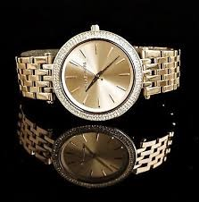 Stunning ladies unworn Michael Kors NY Couture gold plated diamante watch.