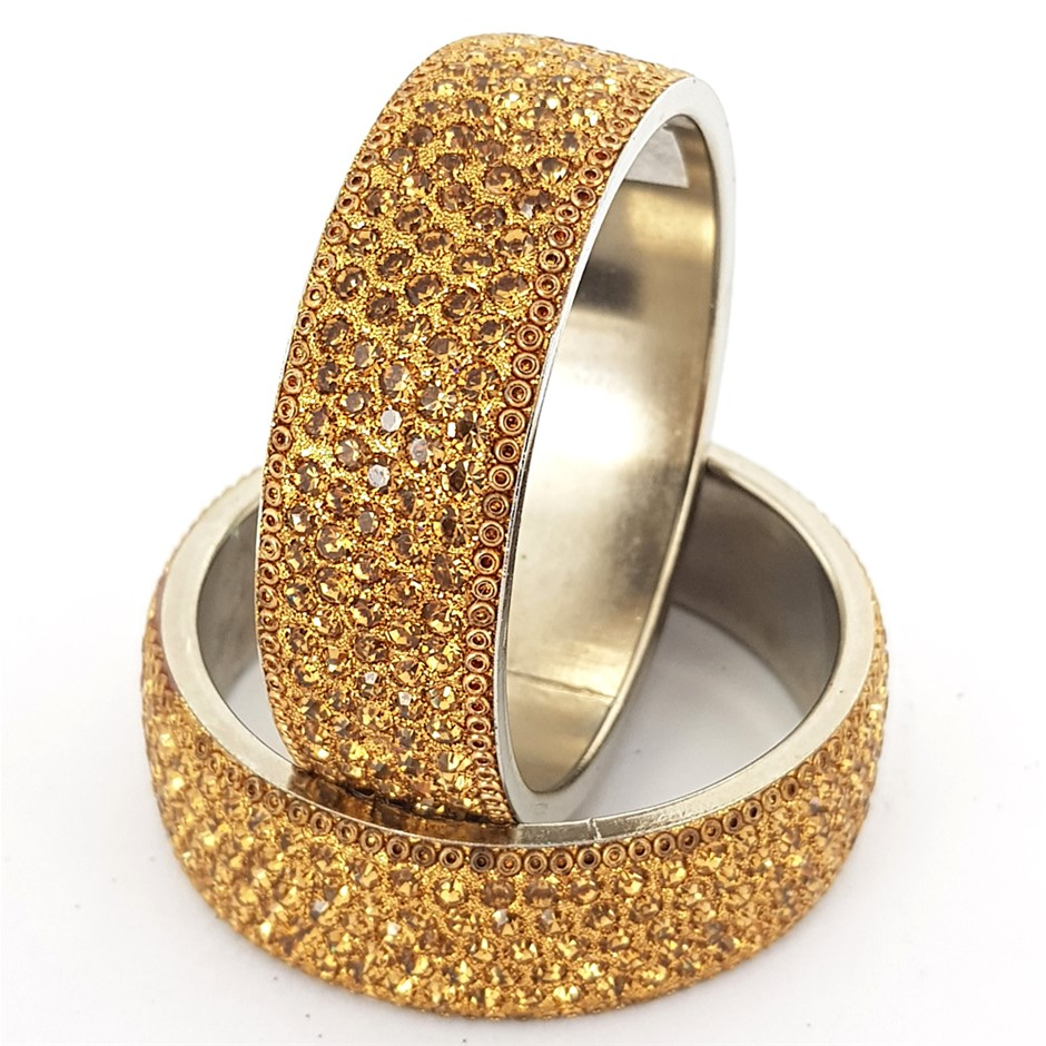 Two Gold Crystal Bangles.