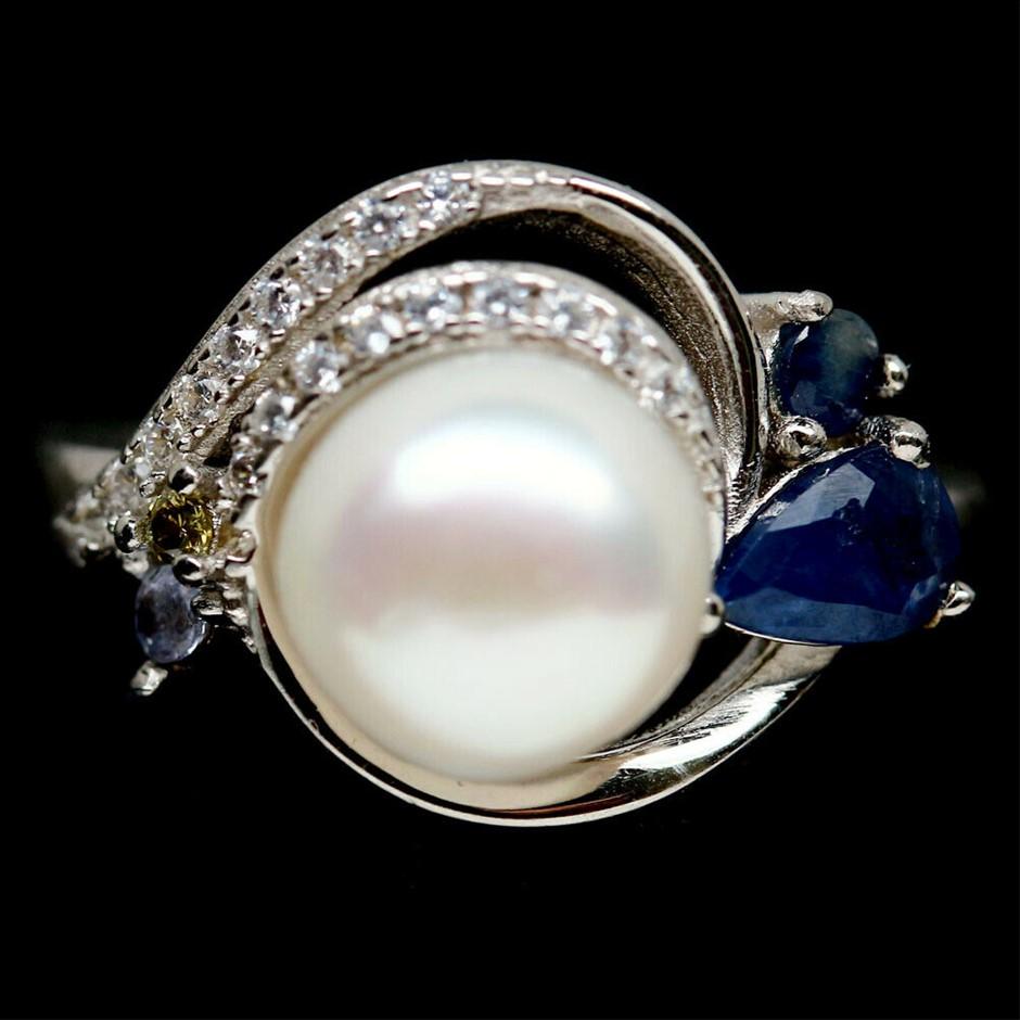 Striking Genuine Pearl & Sapphire Ring.