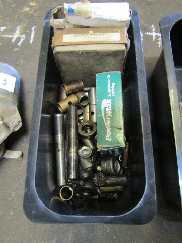 Unused and used Tub of King Pin parts