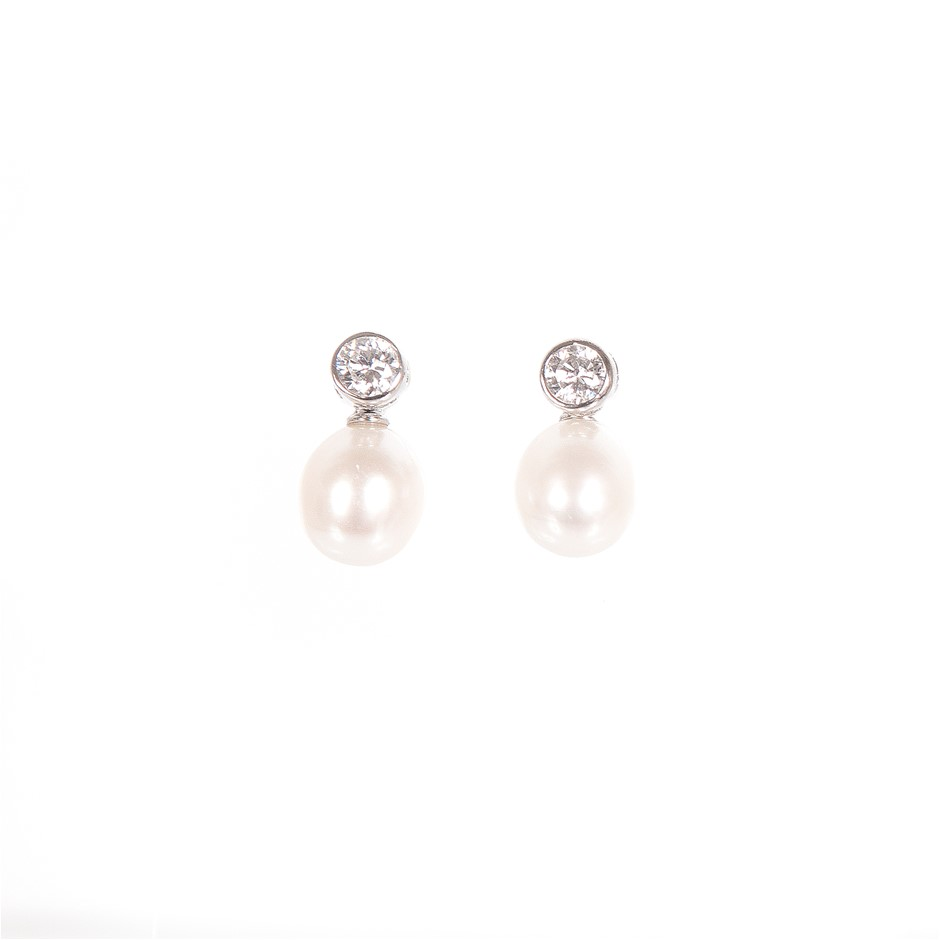 A Pair Of Sterling Silver 925 White Freshwater Pearl Earrings