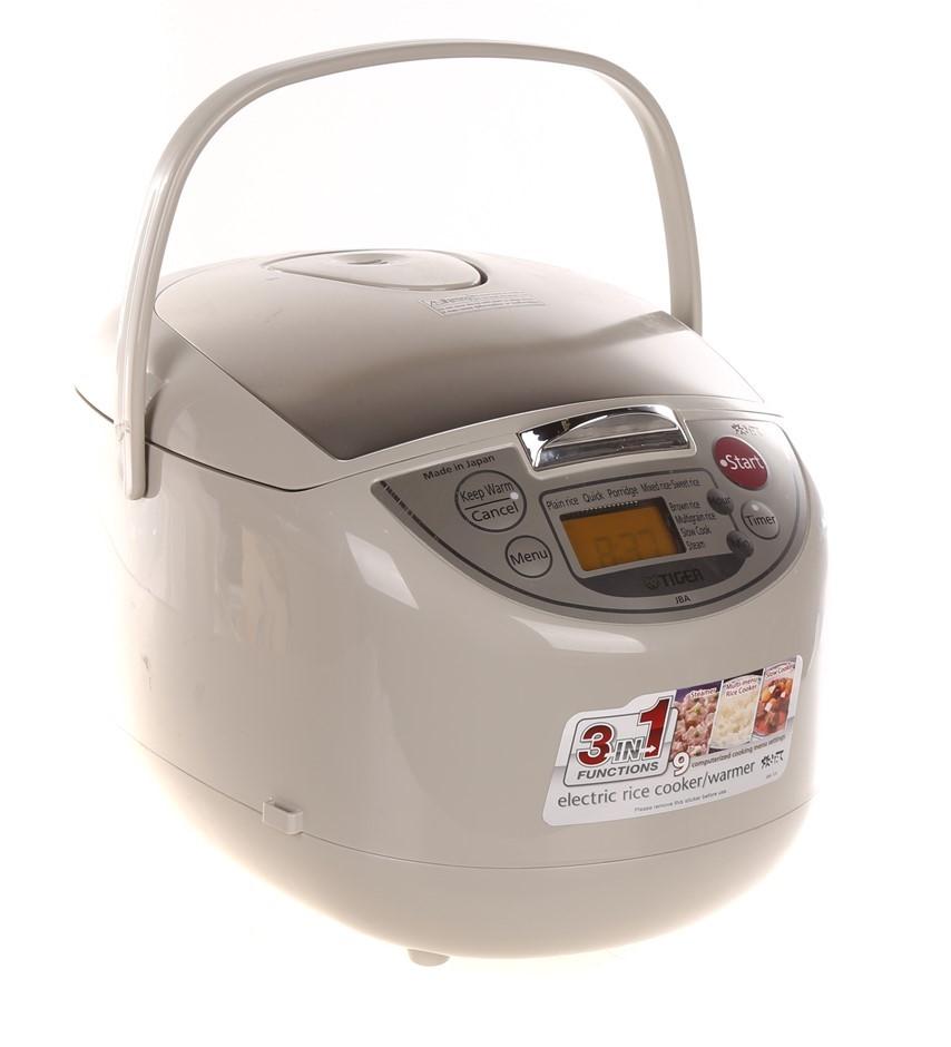 TIGER 3-in-1 Electric Rice Cooker/Warmer, Model JBA-T18A. N.B. Used , in wo