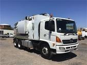 Hino FH Vac Truck & Komatsu PC138US-8 Excavator