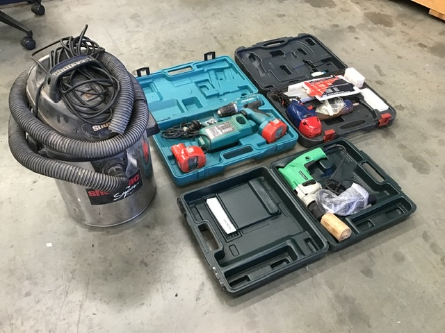 Assorted Power Tools in Cases
