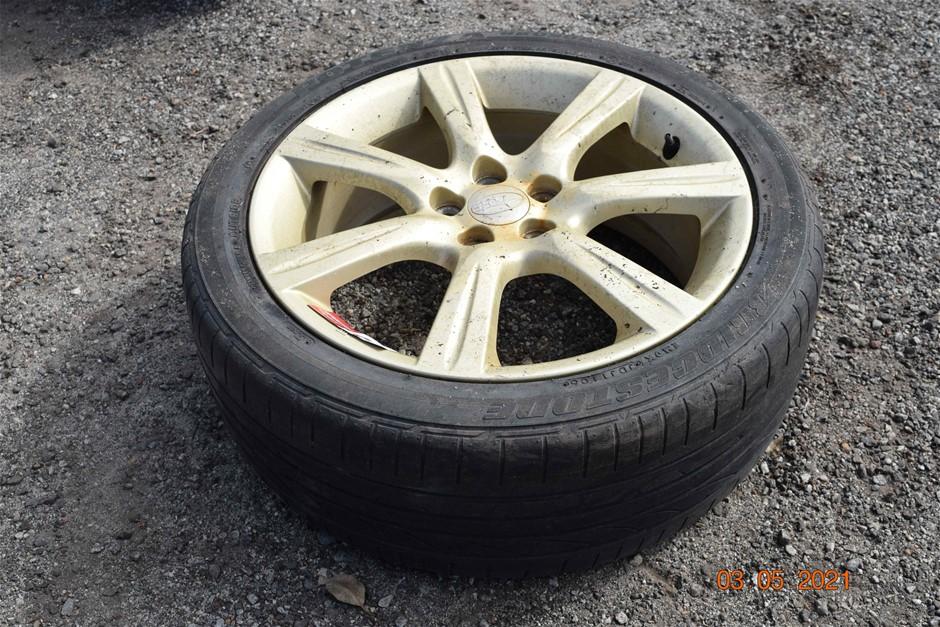 Bridgestone 215/45 R17 Low Profile Tyre on Subaru 5 Stud / 7 Spoke Rim