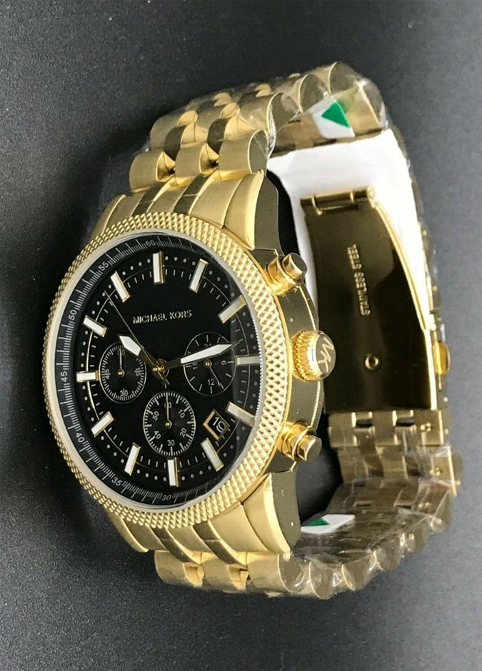 Mens new gold plated Michael Kors Couture NY very modern chrono. watch.